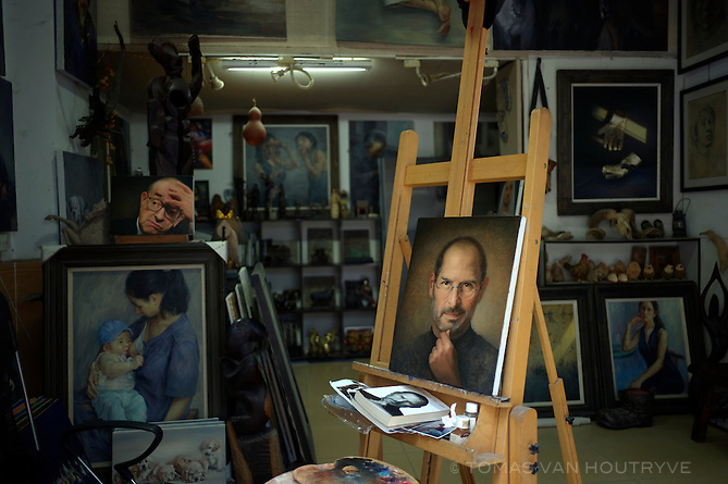Paintings of Steve Jobs and Alan Greenspan are seen in a gallery in the Dafen area of Shenzhen, China on Feb. 6 2012. In addition to original art works, Dafen produces thousands of inexpensive reproductions which are sold to hotels around the world.