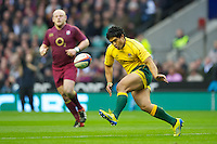 Ben Tapuai of Australia chips ahead during the Cook Cup between England and Australia, part of the QBE International series, at Twickenham on Saturday 17th November 2012 (Photo by Rob Munro)