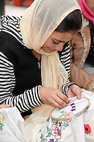 Dehradun, India.  Indian Muslim Woman Embroidering.