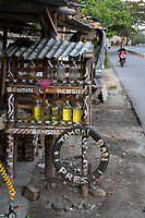 Yogyakarta, Java, Indonesia.  Gasoline for Motorbikes is Sold in Recycled Liquor Bottles at Roadside Stands.