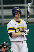 Michigan Wolverines shortstop Travis Maezes (9) at bat during the NCAA baseball game against the Washington Huskies on February 16, 2014 at Bobcat Ballpark in San Marcos, Texas. The game went eight innings, before travel curfew ended the contest in a 7-7 tie. (Andrew Woolley/Four Seam Images)
