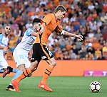 BRISBANE, AUSTRALIA - OCTOBER 30: Thomas Kristensen of the Roar and Paulo Retre of Melbourne compete for the ball during the round 5 Hyundai A-League match between the Brisbane Roar and Melbourne City at Suncorp Stadium on November 4, 2016 in Brisbane, Australia. (Photo by Patrick Kearney/Brisbane Roar)