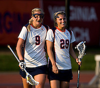 Marye Kellermann (29) and Whitaker Hagerman (9) of Virginia celebrate the win after the first round of the ACC Women's Lacrosse Championship in College Park, MD.  Virginia defeated Virginia Tech, 18-6.