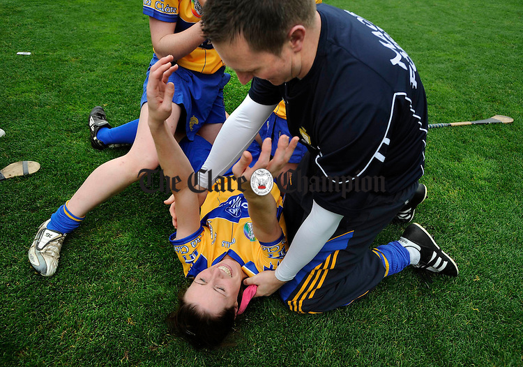 Jane Scanlan and trainer Eoghan Hanley celebrate their win after the final whistle in the All-Ireland junior camogie final at Croke Park. Photograph by John Kelly.