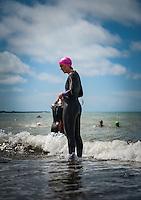 Aberystwyth, West Wales, UK Weather: A woman prepares to go for a swim in Aberystwyth, Wales, UK