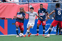 FOXBOROUGH, MA - JULY 25: Joaquín Torres #18 of CF Montreal brings the ball forward with Jon Bell #22 of New England Revolution in pursuit during a game between CF Montreal and New England Revolution at Gillette Stadium on July 25, 2021 in Foxborough, Massachusetts.