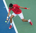 Novak Djokovic (SRB) defeats Marcel Granollers (ESP) 6-3, 6-0, 6-0 at the US Open being played at USTA Billie Jean King National Tennis Center in Flushing, NY on September 3, 2013