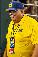 University of Michigan Athletic Director Warde Manuel in the dugout after Game 6 of the NCAA College World Series against the Florida State Seminoles on June 17, 2019 at TD Ameritrade Park in Omaha, Nebraska. Michigan defeated Florida State 2-0. (Andrew Woolley/Four Seam Images)