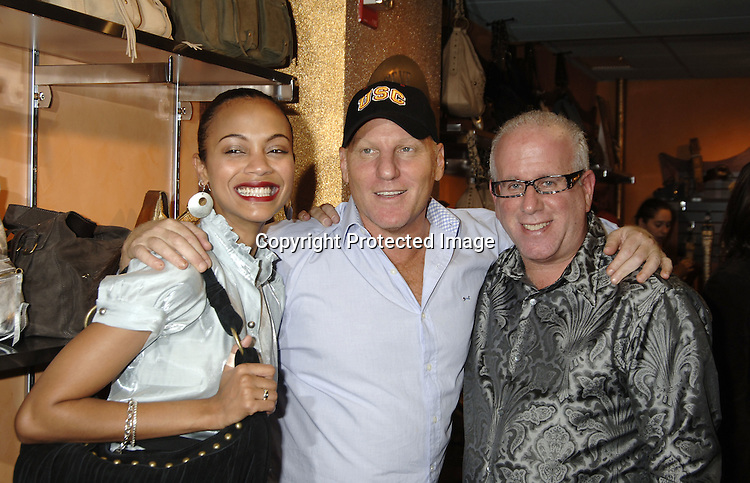 Zoe Saldana, Steve Madden and Kenny Horowitz ..at a party to unveil a new line of leather handbags and belts for Spring 2006 by Steve Madden in partnership with Daniel M. Friedman & Associates on November 9, 2005 at the Daniel M. Friedman Showroom. ..Photo by Robin Platzer, Twin Images
