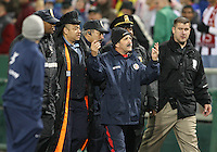 Rene Simoes head coach of Costa Rica is lead from the field by the police during a 2010 World Cup qualifying match against the USA in the CONCACAF region at RFK Stadium on October 14 2009, in Washington D.C.The match ended in a 2-2 tie.