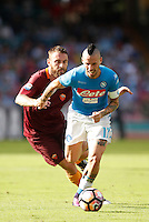 Calcio, Serie A: Napoli vs Roma. Napoli, stadio San Paolo, 15 ottobre. <br /> Napoli's Marek Hamsik, right, is chased by Roma's Daniele De Rossi during the Italian Serie A football match between Napoli and Roma at Naples' San Paolo stadium, 15 October 2016. Roma won 3-1.<br /> UPDATE IMAGES PRESS/Isabella Bonotto