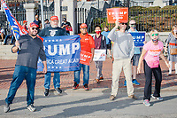 A small contingent of Trump supporters gathered outside the Massachusetts State House in Boston, Massachusetts, on Sat., Nov. 7, 2020 to taunt those celebrating the victory of US President-Elect Joe Biden over incumbent Donald Trump. The Trump supporters mentioned being part of the Stop The Steal movement.