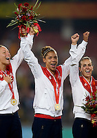 USWNT teammates Lauren Cheney, Natasha Kai and Heather Mitts celebrate their win after playing for the gold medal at Workers' Stadium.  The USWNT defeated Brazil, 1-0, during the 2008 Beijing Olympic final in Beijing, China.