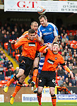 Dundee United v St Johnstone.....04.05.13      SPL.Frazer Wright gets above Sean Dillon, John Souttar and Luke Johnston.Picture by Graeme Hart..Copyright Perthshire Picture Agency.Tel: 01738 623350  Mobile: 07990 594431