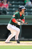 Center fielder Cole Sturgeon (35) of the Greenville Drive bats in a game against the Asheville Tourists on Sunday, July 20, 2014, at Fluor Field at the West End in Greenville, South Carolina. Sturgeon is a 2014 draft pick of the Boston Red Sox out of the University of Louisville. Asheville won game one of a doubleheader, 3-1. (Tom Priddy/Four Seam Images)