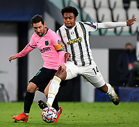 Football Soccer: UEFA Champions League -Group Stage-  Group G - Juventus vs FC Barcellona, Allianz Stadium. Turin, Italy, October 28, 2020.<br /> Barcellona's captain Lionel Messi (l) in action with Juventus' Weston McKennie (r) during the Uefa Champions League football soccer match between Juventus and Barcellona at Allianz Stadium in Turin, October 28, 2020.<br /> UPDATE IMAGES PRESS/Isabella Bonotto