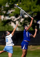 Kristen Carr (6) of North Carolina fights for the ball against Kat Thomas (4) of Duke during the ACC women's lacrosse tournament semifinals in College Park, MD.  North Carolina defeated Duke, 14-4.