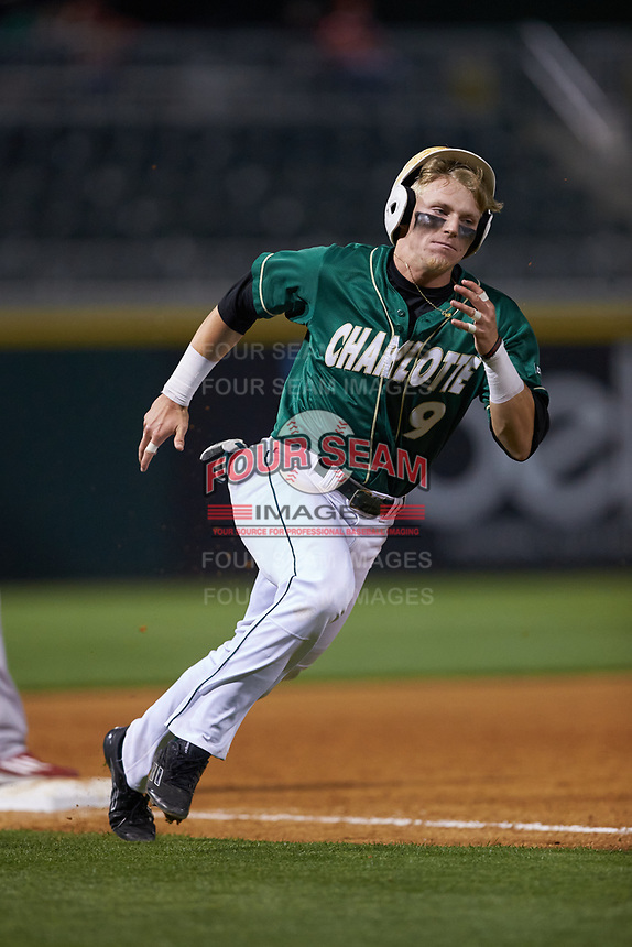 Brett Netzer (9) of the Charlotte 49ers hustles around third base during the game against the North Carolina State Wolfpack at BB&T Ballpark on March 29, 2016 in Charlotte, North Carolina. The Wolfpack defeated the 49ers 7-1.  (Brian Westerholt/Four Seam Images)