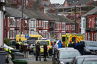 Pictured: General view of Raffles Road in Birkenhead, Merseyside, where armed police have placed a containment on a terraced house.<br />