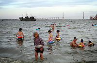Local residents take to the water to escape the summer heat in the city of Zhanjiang, Guangdong Province. 2010