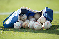 A bag of practice baseballs on the field prior to the South Atlantic League game between the Lexington Legends and the Kannapolis Intimidators at CMC-Northeast Stadium on May 25, 2015 in Kannapolis, North Carolina.  The Intimidators defeated the Legends 6-5.  (Brian Westerholt/Four Seam Images)
