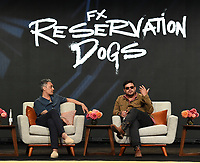"""BEVERLY HILLS, CA - AUGUST 4: Co-Creator/Executive Producer/Writer Taika Waititi (L) and Co-Creator/Writer/Director Sterlin Harjo attend the FX Networks 2021 Summer Television Critics Association session for """"Reservation Dogs"""" at the Beverly Hilton on August 4, 2021 in Beverly Hills, California. (Photo by Frank Micelotta/FX/PictureGroup)"""