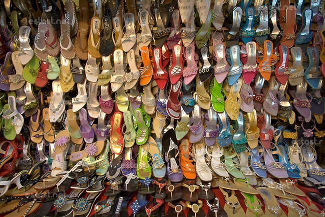 AFGHANISTAN, 06.2008, Kabul. Markt/Basar: Die Menge verschiedener Farben und Stile von Sommerschuhen, zeigt, dass die Frauen auch unter der Burka schoen aussehen wollen.   Market/Bazaar: Summer shoes. The variety of colours and styles shows that women want to look nice even under the burqa.<br /> © Marzena Hmielewicz/EST&OST