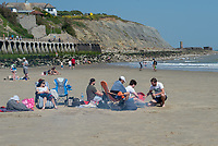 FOLKESTONE, KENT, England - 30.05.2020<br /> .<br /> People enjoy a barbecue on the beach in the summer weekend sun by relaxing at Folkestone Harbour, as the government lockdown is due to be relaxed further on Monday including allowing groups of 6 to meet up as the COVID-19 pandemic continues in High Wycombe, Bucks on 30 May 2020. Photo by Alan Stanford.