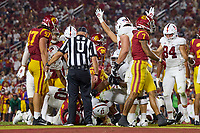 LOS ANGELES, CA - SEPTEMBER 11: Tanner McKee #18 of the Stanford Cardinal scores on a quarterback keeper during a game between University of Southern California and Stanford Football at Los Angeles Memorial Coliseum on September 11, 2021 in Los Angeles, California.