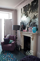 Detail of the fireplace in the first floor reception room. A statement painting hangs above the mantelpiece with its select collection of vases