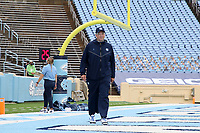 CHAPEL HILL, NC - OCTOBER 10: North Carolina Offensive Line Coach Stacey Searels walks across the end zone before a game between Virginia Tech and North Carolina at Kenan Memorial Stadium on October 10, 2020 in Chapel Hill, North Carolina.
