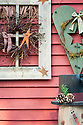 rustic snowman wreath cutouts holiday decorations on red barn wall