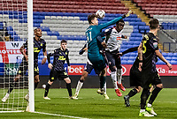 Bolton Wanderers' Arthur Gnahoua competing with Newcastle United U21's goalkeeper Daniel Langley<br /> <br /> Photographer Andrew Kearns/CameraSport<br /> <br /> EFL Papa John's Trophy - Northern Section - Group C - Bolton Wanderers v Newcastle United U21 - Tuesday 17th November 2020 - University of Bolton Stadium - Bolton<br />  <br /> World Copyright © 2020 CameraSport. All rights reserved. 43 Linden Ave. Countesthorpe. Leicester. England. LE8 5PG - Tel: +44 (0) 116 277 4147 - admin@camerasport.com - www.camerasport.com