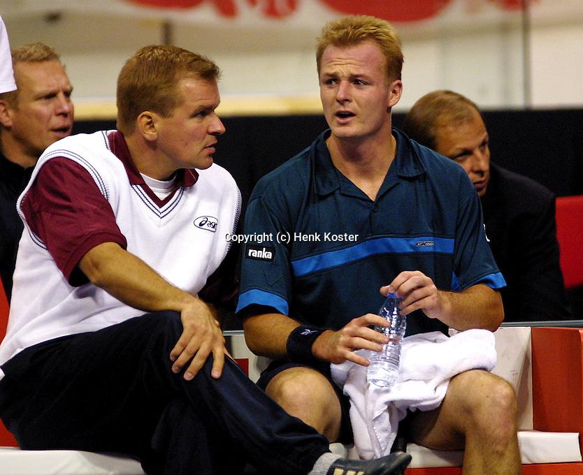 Coach Henrik Johanson and Ketola