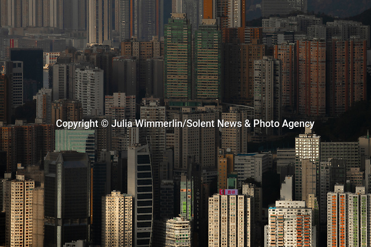 Pictured: Photos show the vast skyline of Hong Kong - one of the richest cities in the world.   It is home to the second highest number of billionaires and the third highest monthly rent prices in the world.<br /> <br /> The island's striking skyline is made up of a mixture of towering residential and office buildings.   The photographs were taken by photographer Julia Wimmerlin, who took them from Victoria Peak on the island, and Kowloon Peak on the mainland.   SEE OUR COPY FOR DETAILS<br /> <br /> Please byline: Julia Wimmerlin/Solent News<br /> <br /> © Julia Wimmerlin/Solent News & Photo Agency<br /> UK +44 (0) 2380 458800