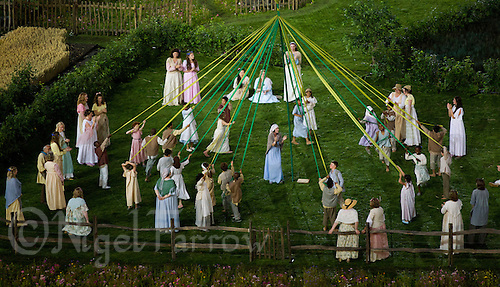 """27 JUL 2012 - LONDON, GBR - Actors dance round a Maypole during the """"Green and Pleasant Land"""" section of the Opening Ceremony of the London 2012 Olympic Games in the Olympic Stadium in the Olympic Park, Stratford, London, Great Britain .(PHOTO (C) 2012 NIGEL FARROW)"""