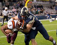 Pitt running back George Aston makes a tackle on Virginia Tech kickoff return man Greg Stroman. The Virginia Tech Hokies defeated the Pitt Panthers 39-36 on October 27, 2016 at Heinz Field in Pittsburgh, Pennsylvania.