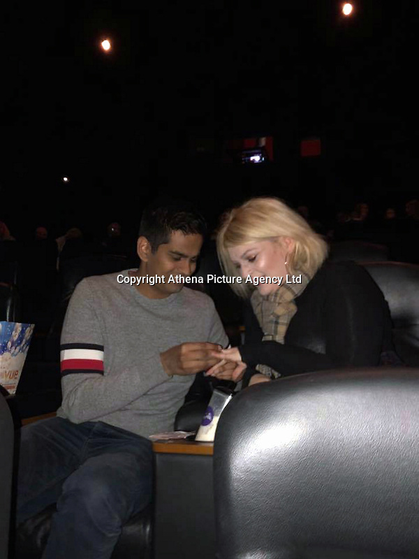 """Pictured: Damian Paul offers an engagement ring to Louise Treen at the Vue cinema in Merthyr Tydfil, Wales, UK.<br /> Re: A man asked his girlfriend to marry him by getting a cinema to screen his homemade proposal video during the trailers.<br /> 28 year old Damian Paul, asked staff at Vue cinema in Merthyr Tydfil's to show the video before a screening of Paddington 2.<br /> His girlfriend Louise Treen, 29, said yes.<br /> """"This is easily the biggest and greatest surprise of my life,"""" she said."""