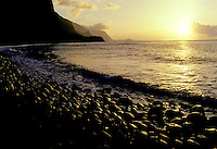 The remote coastline of Molokai's north shore at sunrise shot from Wailau Valley.