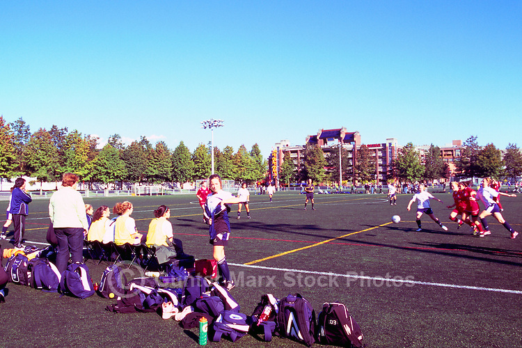 Ladies playing Soccer on Sports Field at Andy Livingstone Park, Downtown Vancouver, BC, British Columbia, Canada