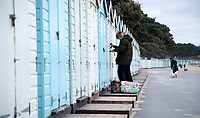 BNPS.co.uk (01202 558833)<br /> Pic: CorinMesser/BNPS<br /> <br /> Successful new tenant...<br /> <br /> We will fight them for the beach huts...<br /> <br /> A group of hardy souls queued up a day early in the freezing cold to secure a sought-after beach hut for the summer.<br /> <br /> They have gone to extreme lengths to snap up the 15 timber cabins available at Avon Beach, Christchurch, Dorset.<br /> <br /> The first in the queue, Jan Ryder, was in position at 6.15am on Sunday, almost 26 hours before the administration office opened at 7.30am today.<br /> <br /> Matthew Cox, 60, a mechanical engineer, was in position just before 7am. He remembers being taken to the beach by his late mother Margaret as a child and has queued up each year for a hut since her passing three years ago.