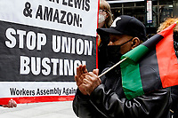 NEW YORK, NEW YORK - MARCH 04: A man claps during a protest to support Amazon workers in Alabama on March 04, 2021 in New York. Amazon is the second largest employer in the United States - with 400,000 workers and about 1.3 million employees worldwide. (Photo by Emaz/VIEWpress)