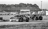 #67 Ferrari 512 of Bob Tullius, Patrick Bedard, and Jean-Pierre Delaunay, 57th place, and #00 Porsche 935 of Preston Henn, Ted Field, and Danny Ongais , 61st place, 24 Hours of Daytona, Daytona International Speedway, Daytona Beach, FL, February 1979. (Photo by Brian Cleary/bcpix.com)
