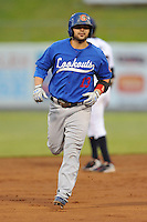 The Chattanooga  Lookouts second baseman Travis Denker #13 rounds the bases after hitting a home run during  game one of the Southern League Northern Division Championship Series between the Chattanooga Lookouts and the Tennessee Smokies at Smokies Park on September 8, 2011 in Kodak, Tennessee.  The Smokies won the game 9-6.  (Tony Farlow/Four Seam Images)