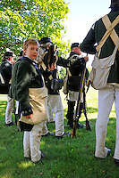 Runner boy of the King's Royal Regiment of New York, loyalists to the British Crown raised in Canada, would carry messages on the battlefield, at a Revolutionary War re-enactment at Fort Ticonderoga, New York, USA.