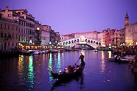 Italy, Venice, The Grand Canal with the Rialto Bridge and a gondola at dusk