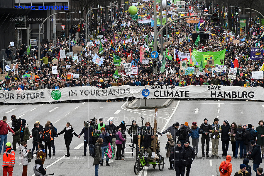 GERMANY, Hamburg city, Fridays for future movement, Save the Climate rally with 30.000 protesters for climate protection, in first row, above the M in word Hamburg: swedish activist Greta Thunberg with her banner skolstrejk för klimatet, / DEUTSCHLAND, Hamburg, Fridays-for future Bewegung, Demo fuer Klimaschutz, erste Reihe über dem M im Wort Hamburg: Greta Thunberg mit ihrem Plakat skolstrejk för klimatet, 21.2.2020