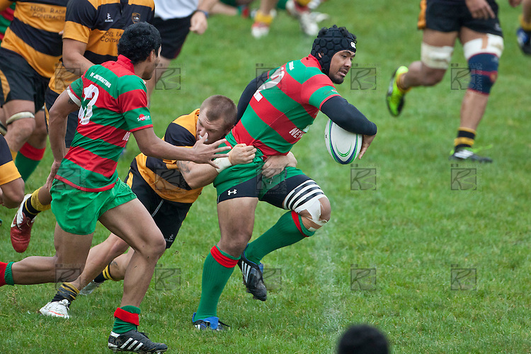 Conall Bromwich slows Sosefo Kata as he makes a break through the Bombay midfield defenses.  Counties Manukau Premier Club Rugby game between Bombay and Waiuku played up on the hill at Bombay on March 26th 2011. Waiuku won 57 - 10 after leading 24 - 3 at halftime.