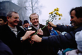 Ostpreu Bendamm, West Germany<br /> November 14, 1989 <br />  <br /> East and West Germans greet each other with flowers as they cross the border near the Berlin Wall. Germans gathered as the wall is dismantled and the East German government lifts travel and emigration restrictions to the West on November 9, 1989.