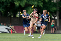 NEWTON, MA - MAY 22: Sydney Scales #45 of Boston College splits the defense during NCAA Division I Women's Lacrosse Tournament quarterfinal round game between Notre Dame and Boston College at Newton Campus Lacrosse Field on May 22, 2021 in Newton, Massachusetts.
